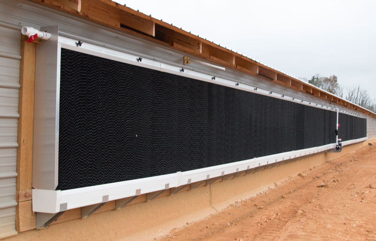 Hog Slat EVAP evaporative cool cell systems are designed with features and improvements that increase performance and reliability for your poultry and swine cooling needs. Our double leg bracket design provides superior support for EVAP systems when attached directly to a barn.