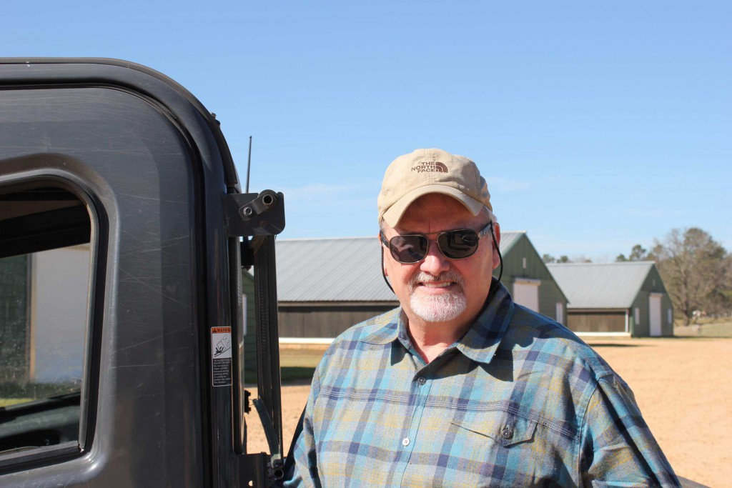 Billy Dossett in front of his 4) 44' x 500' Broiler Houses at Windy Hill Farms.