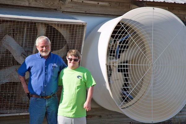 "Rodney and Brett Bowden with new Airstorm 54"" fan"