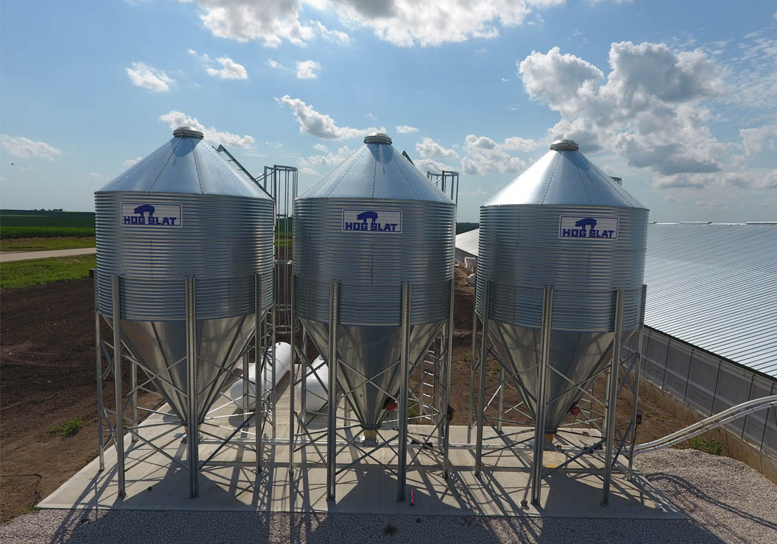 Three 15 ton capacity Hog Slat bulk feed bins with BridgRid anti-bridging systems installed.