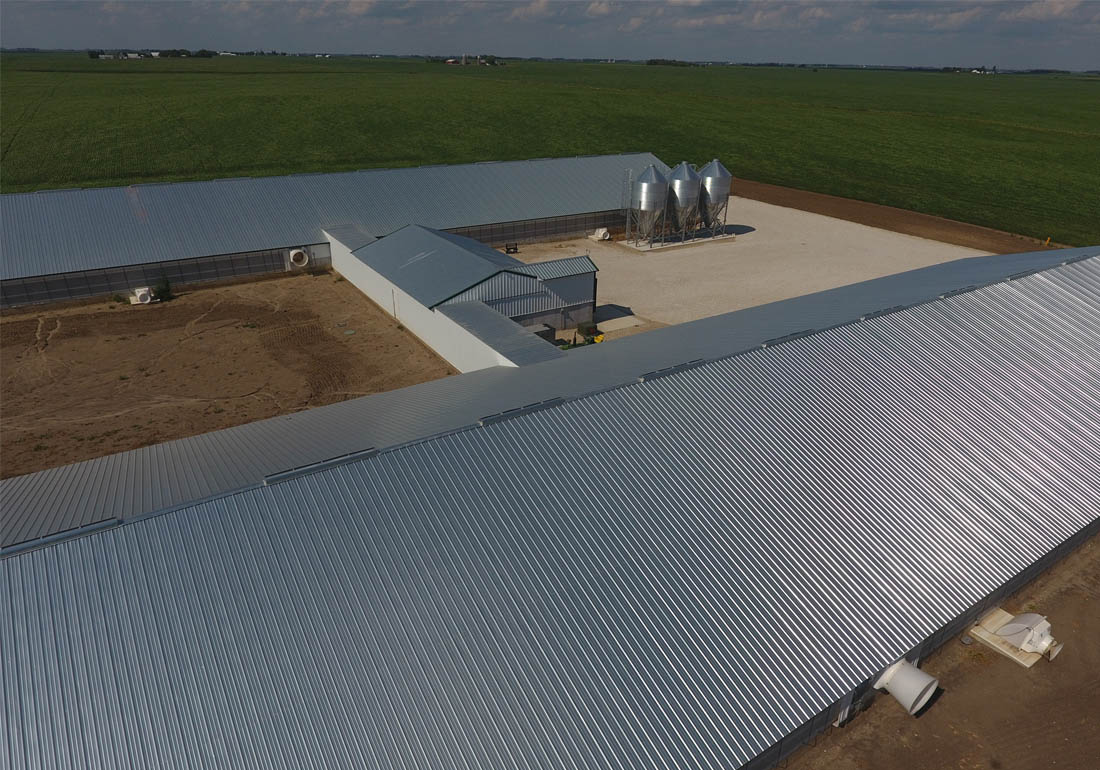 The two barns are connected by an enclosed hallway and attached load out area, office room and storage.