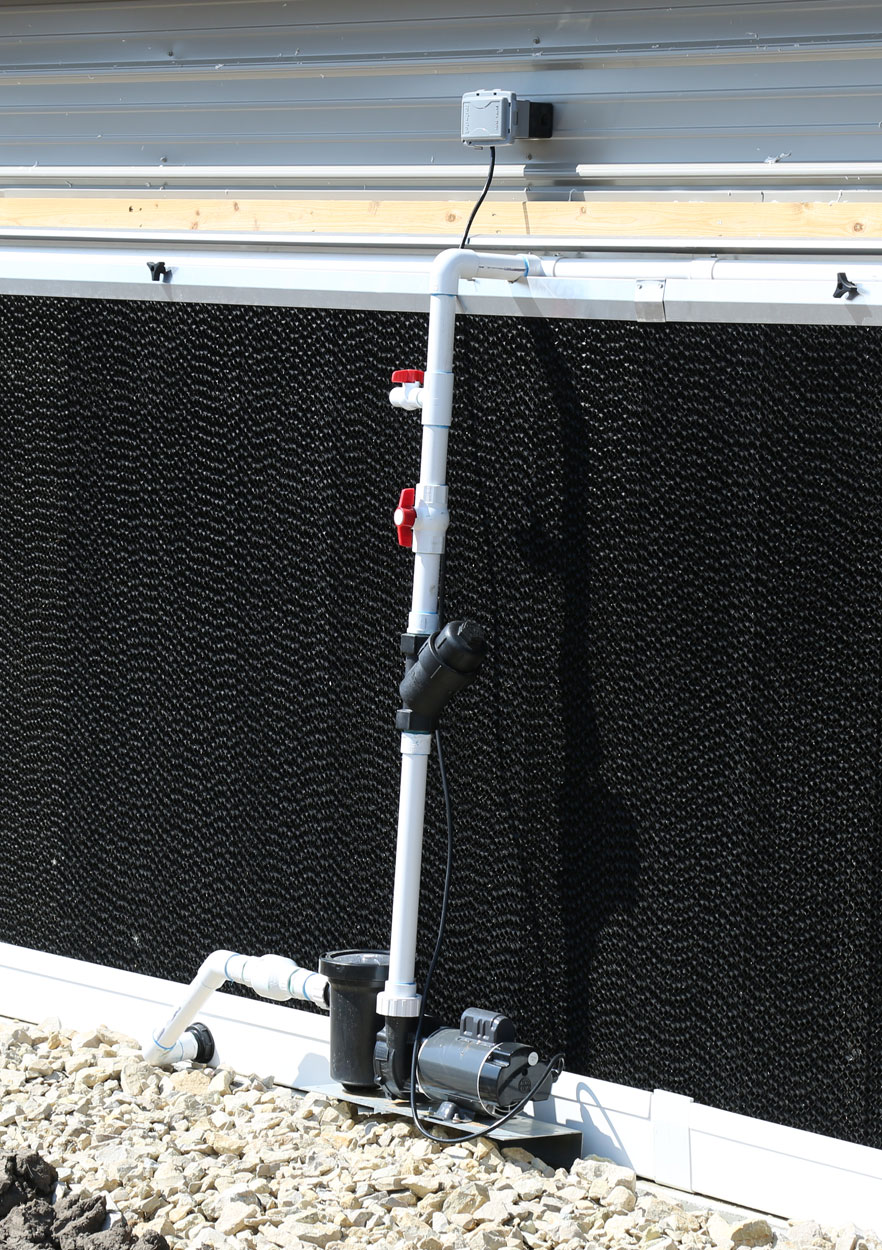 EVAP cooling systems can be operated with an external, self-priming jet pump (shown) or submersible pump tank system. GrowerSELECT jet pumps (shown) provide easy access for seasonal maintenance and cleaning.