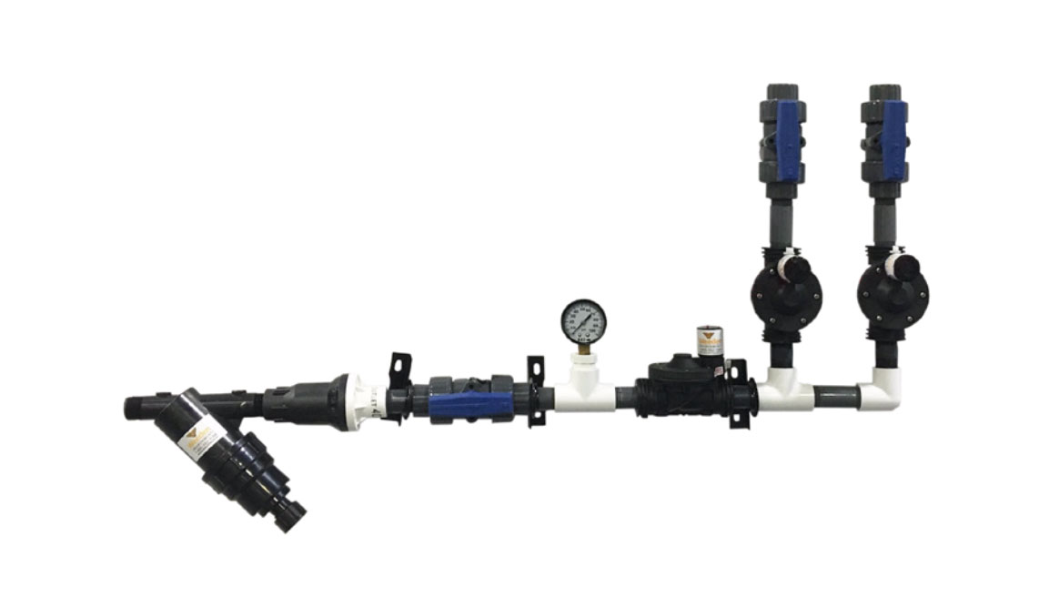 The poultry sprinkler system distributes water through the building from a centralized manifold system, available with 2 or 4 valves depending on installation size.