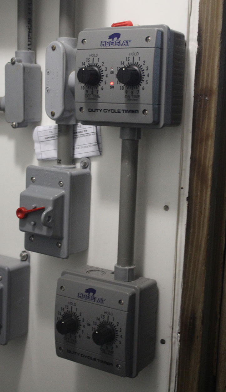 Hog Slat® HST001 Duty Cycle timers were installed in this farrowing barn control room to manage stir fan operation.