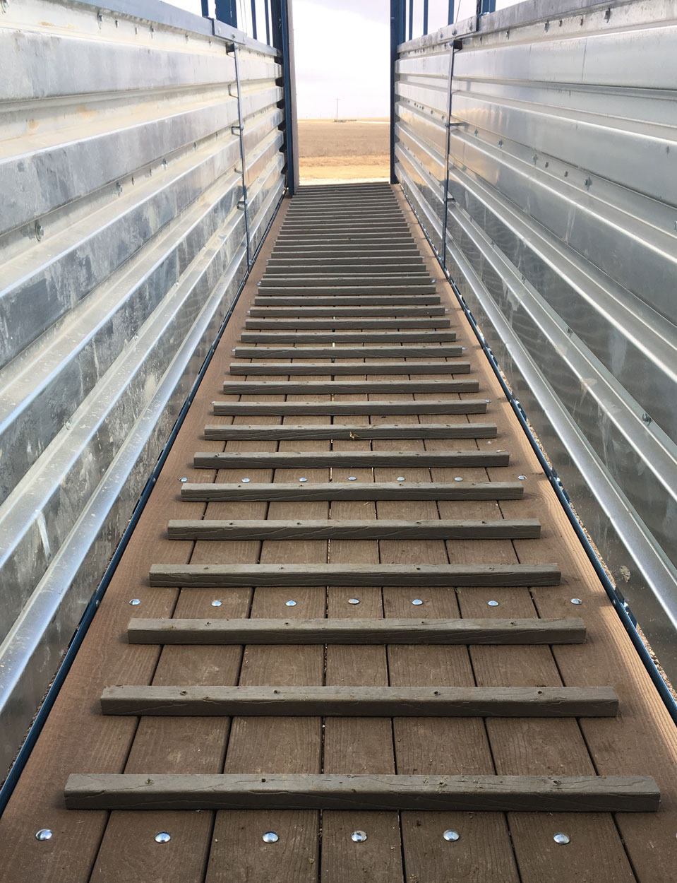 Hog Slat loading chutes feature floor pickets that provide additional traction for pigs when loading at steeper angles or during inclement weather conditions.