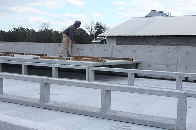 Hog Slat pre-cast pier walls allow faster installation of slat flooring in shallow pit style barns because both the piers and slats can be installed at the same time.