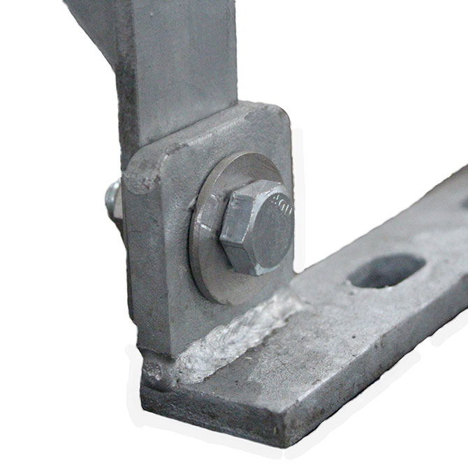 Hot-dipped galvanized floor spacing straps are secured to the barn flooring, providing a solid, pre-spaced anchor point to attach each stanchion panel.